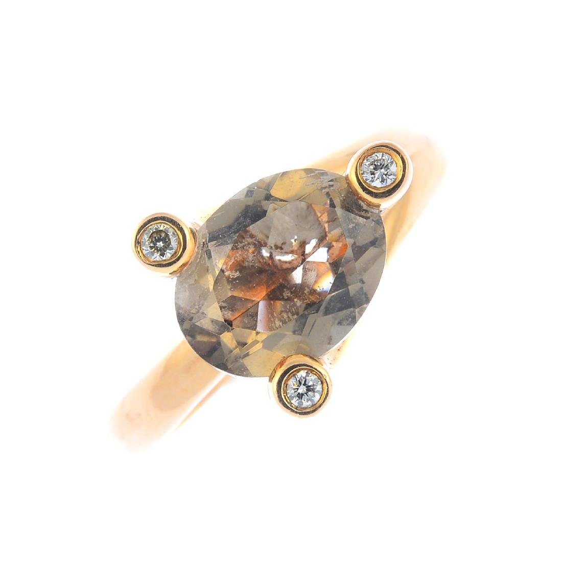 An 18ct gold andalusite and diamond ring. The