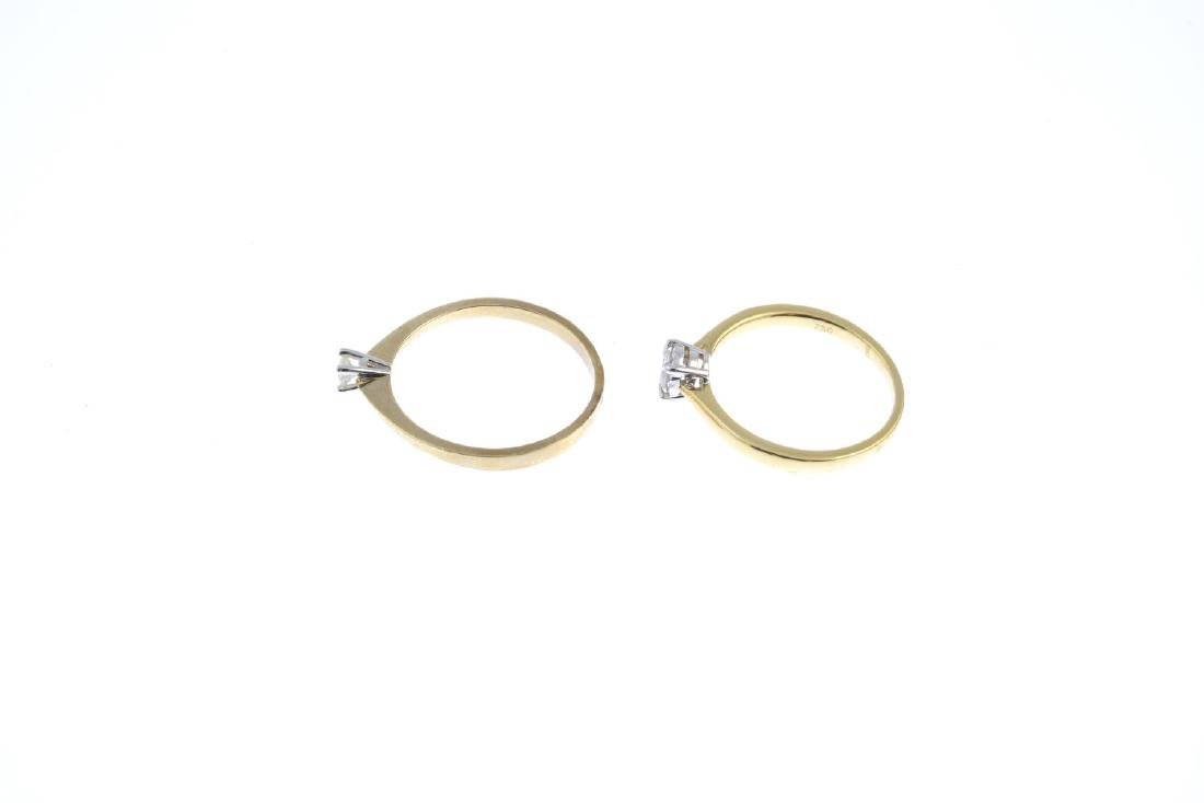 Two gold diamond single-stone rings. Each designed as a - 2