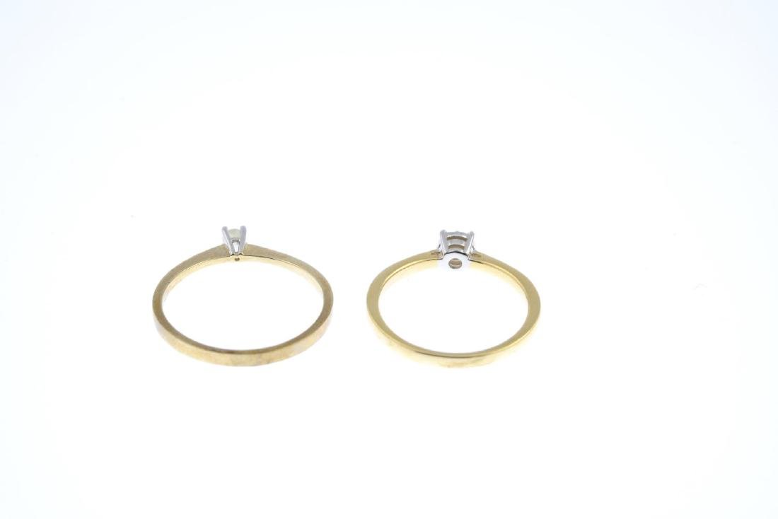 Two gold diamond single-stone rings. Each designed as a - 3