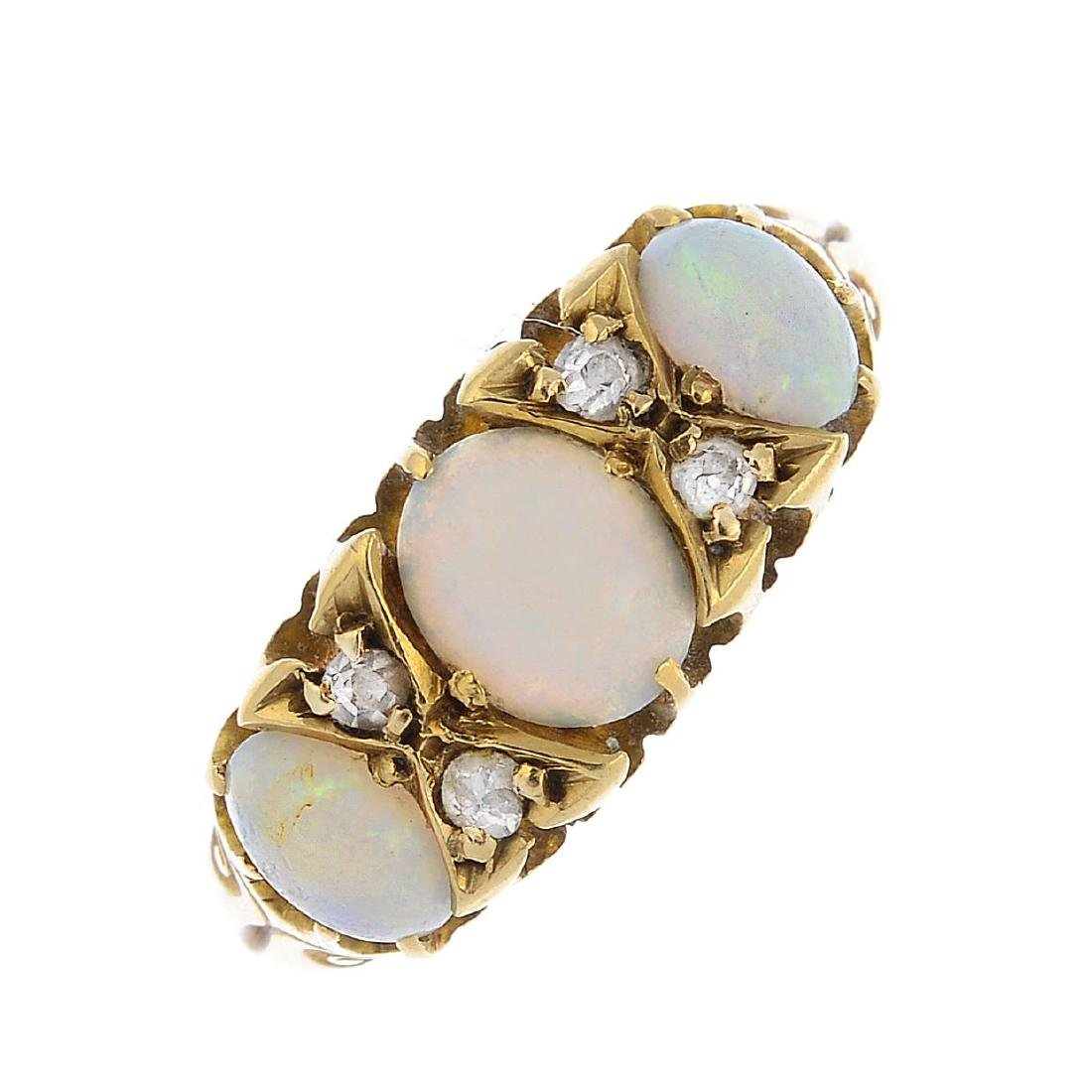 An 18ct gold opal and diamond ring. The graduated oval
