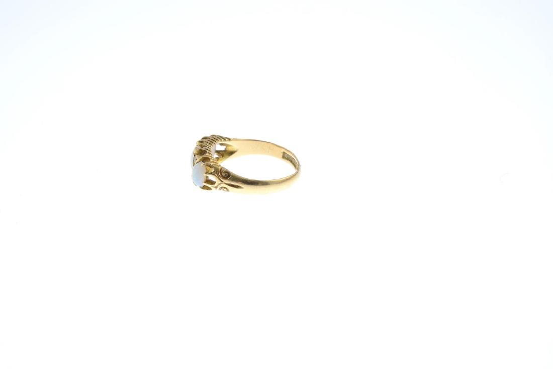 An 18ct gold opal and diamond ring. The graduated oval - 2