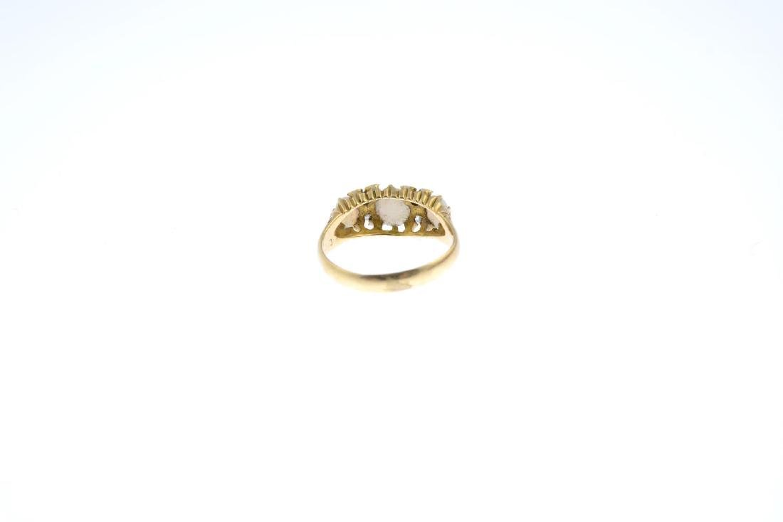 An 18ct gold opal and diamond ring. The graduated oval - 3