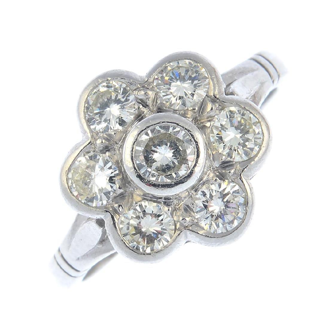 A platinum diamond cluster ring. The brilliant-cut