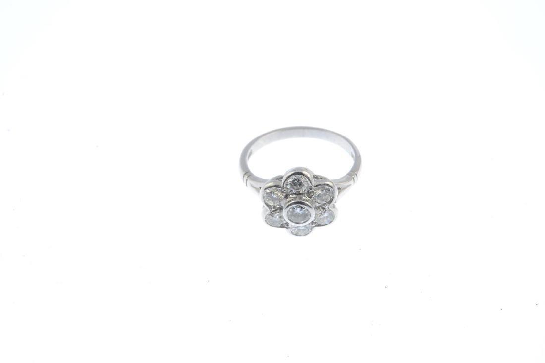 A platinum diamond cluster ring. The brilliant-cut - 2