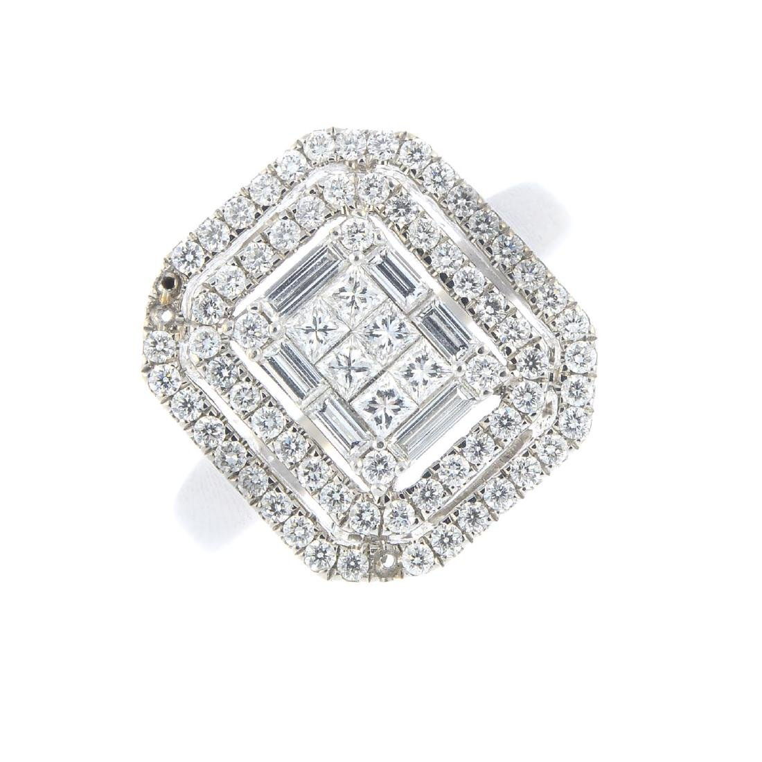 An 18ct gold diamond dress ring. Designed as a vari-cut