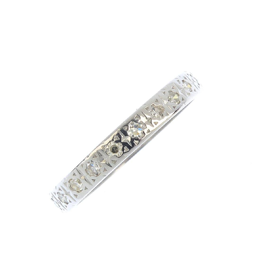 A diamond full eternity ring. Designed as a single-cut