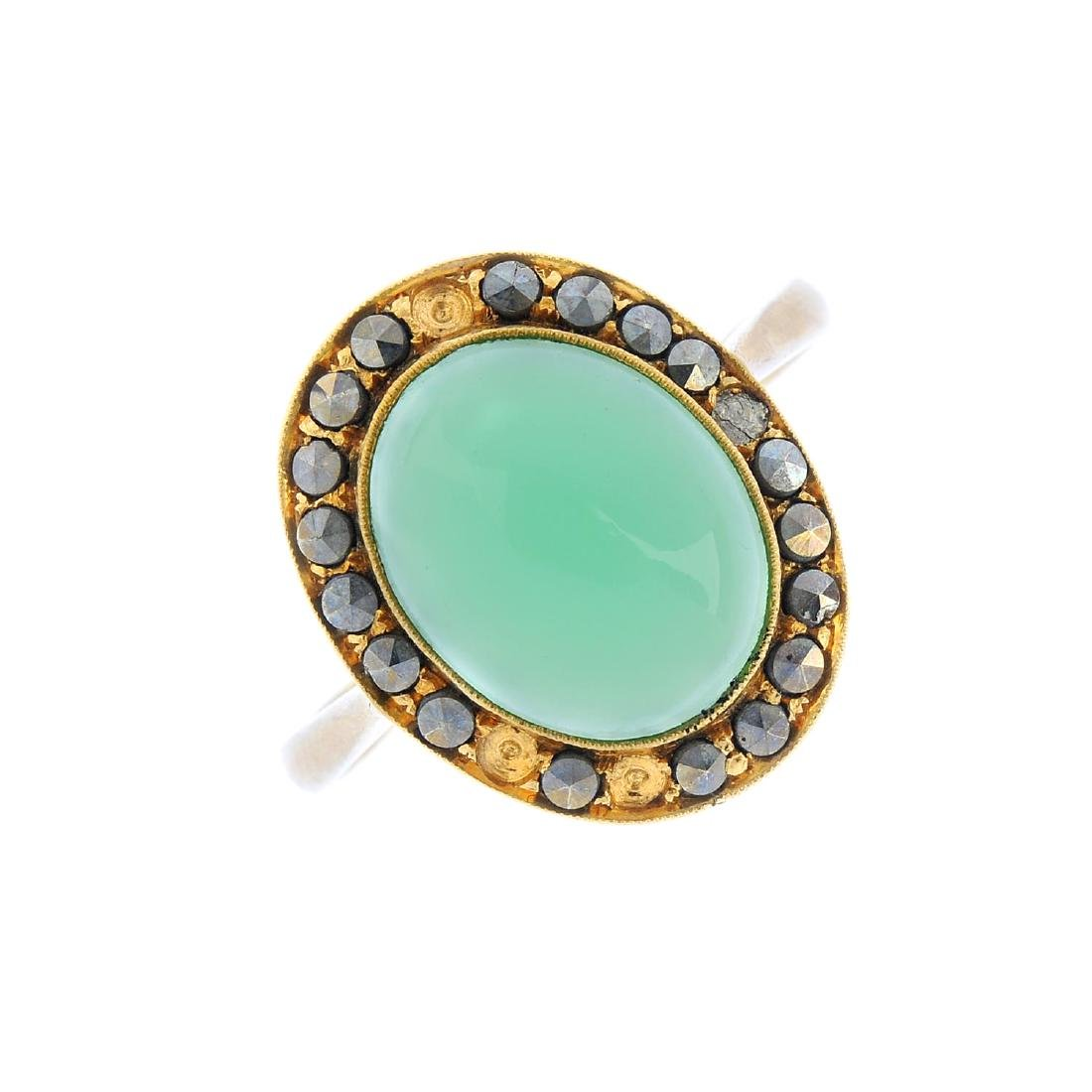 A chrysoprase and marcasite ring. The oval chrysoprase