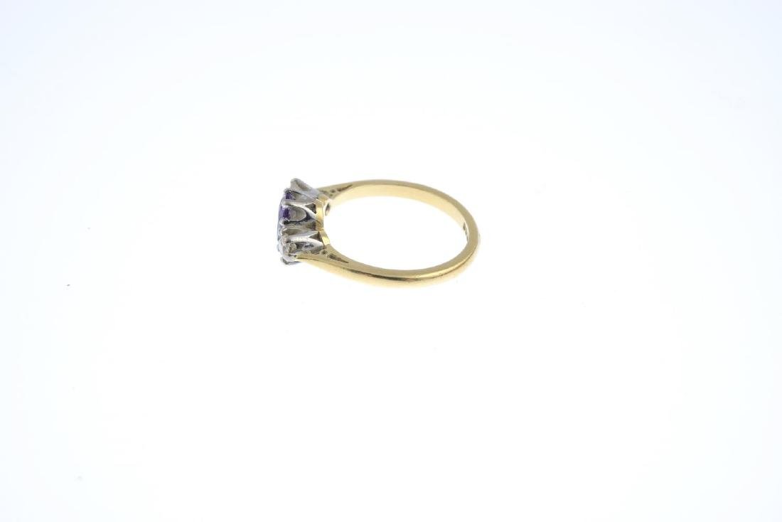 An 18ct gold amethyst and diamond three-stone ring. The - 2