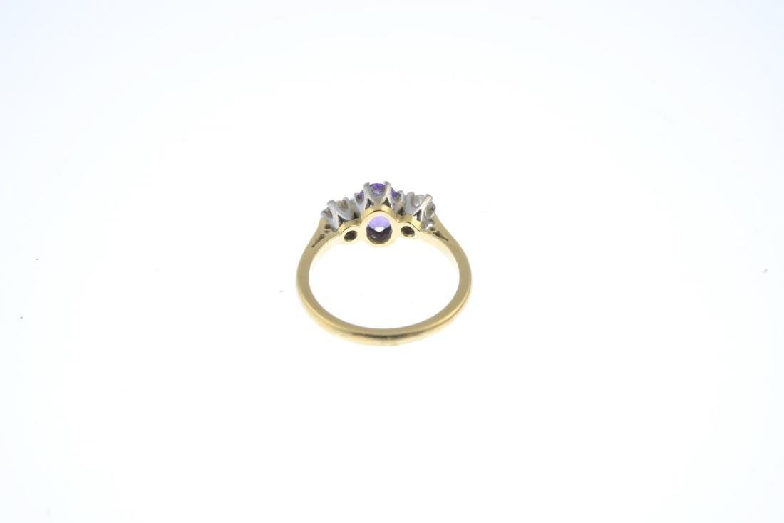 An 18ct gold amethyst and diamond three-stone ring. The - 3