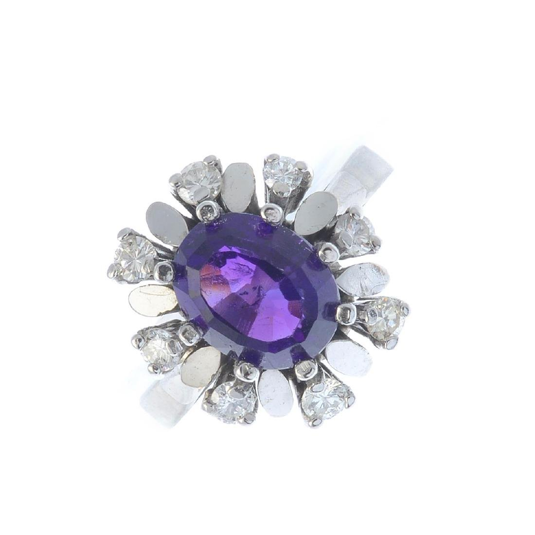 A 1970s 18ct gold amethyst and diamond cluster ring.