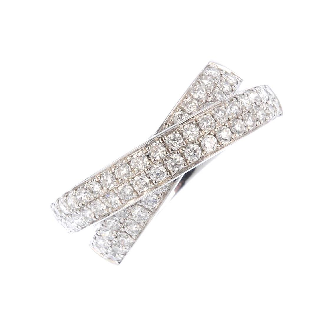 An 18ct gold diamond crossover ring. Designed as two
