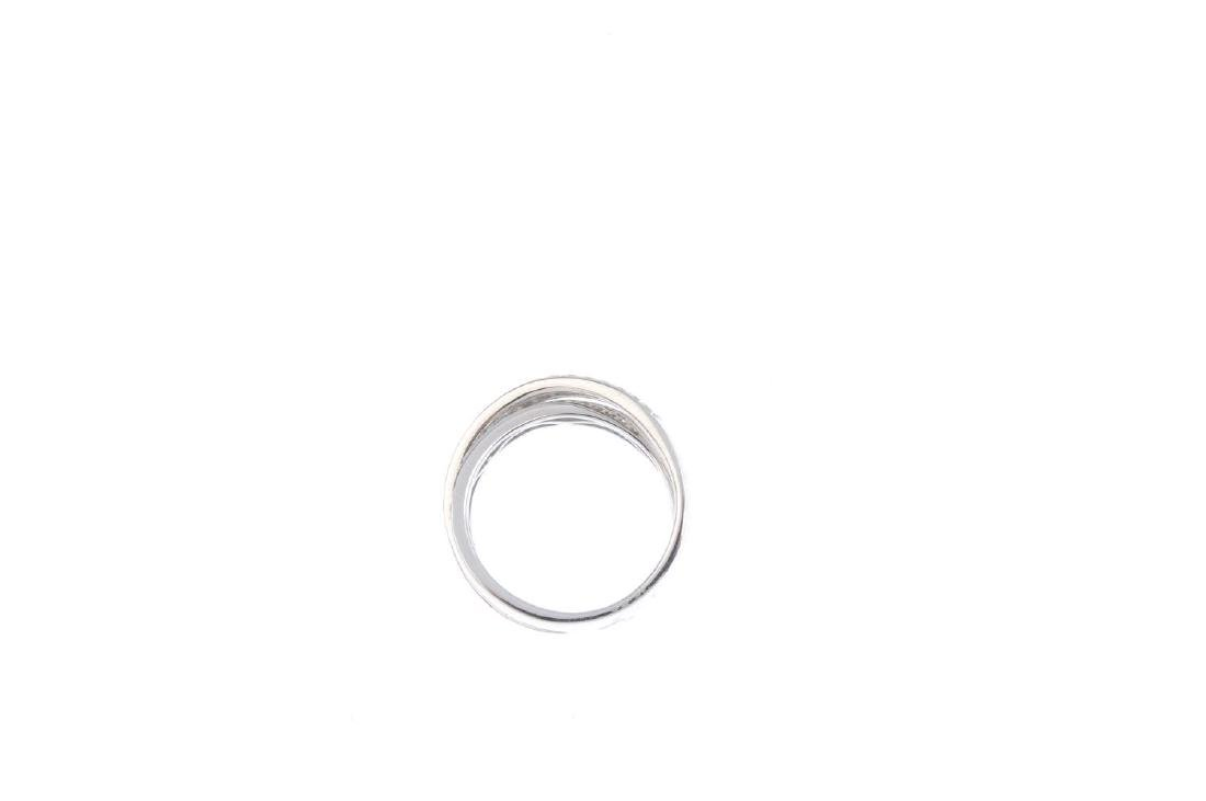 An 18ct gold diamond crossover ring. Designed as two - 2