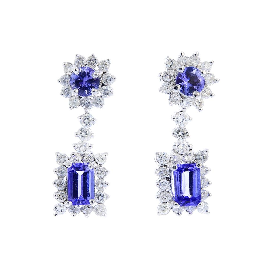 A pair of 18ct gold tanzanite and diamond earrings.