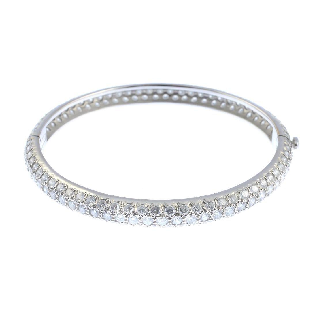 A pave-set brilliant-cut diamond hinged bangle.