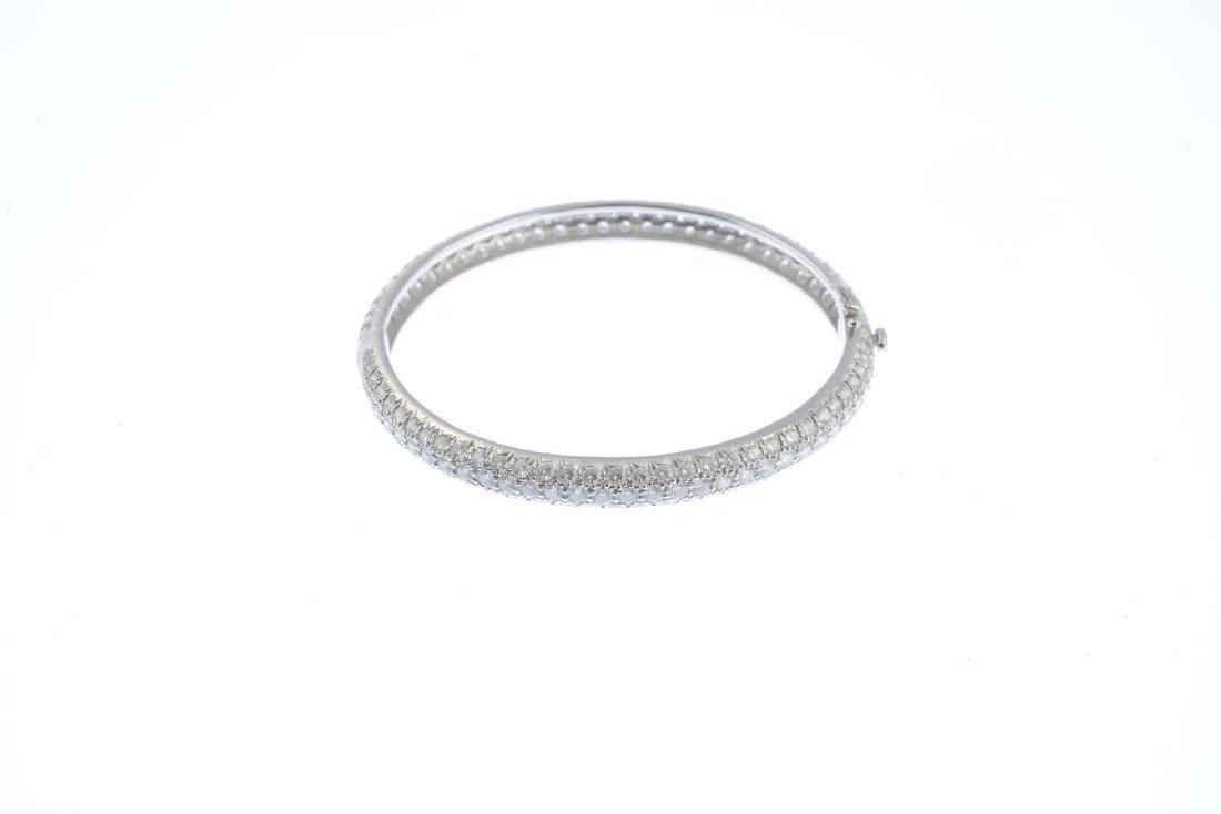 A pave-set brilliant-cut diamond hinged bangle. - 2