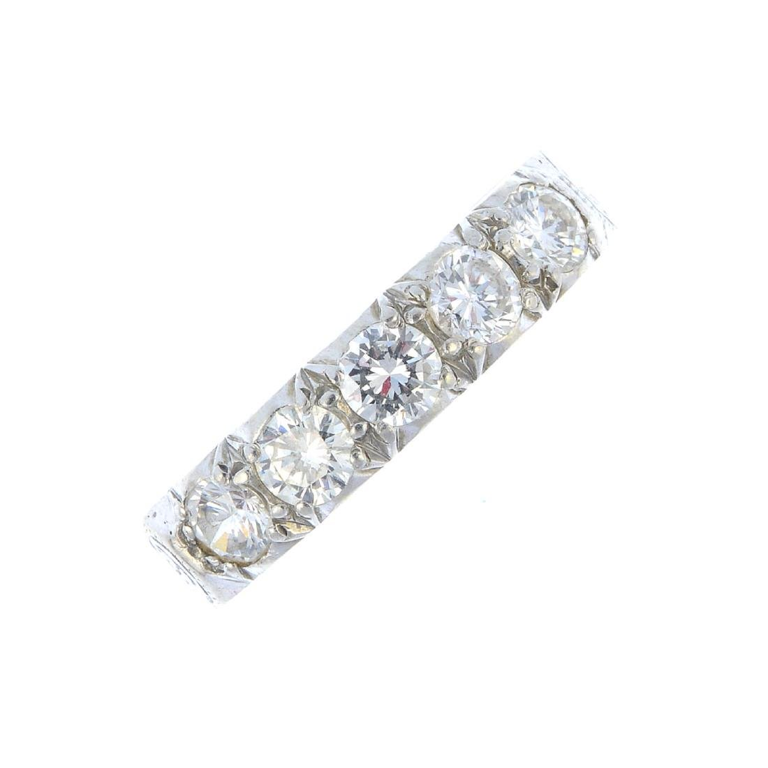 A diamond eternity ring. Designed as a series of