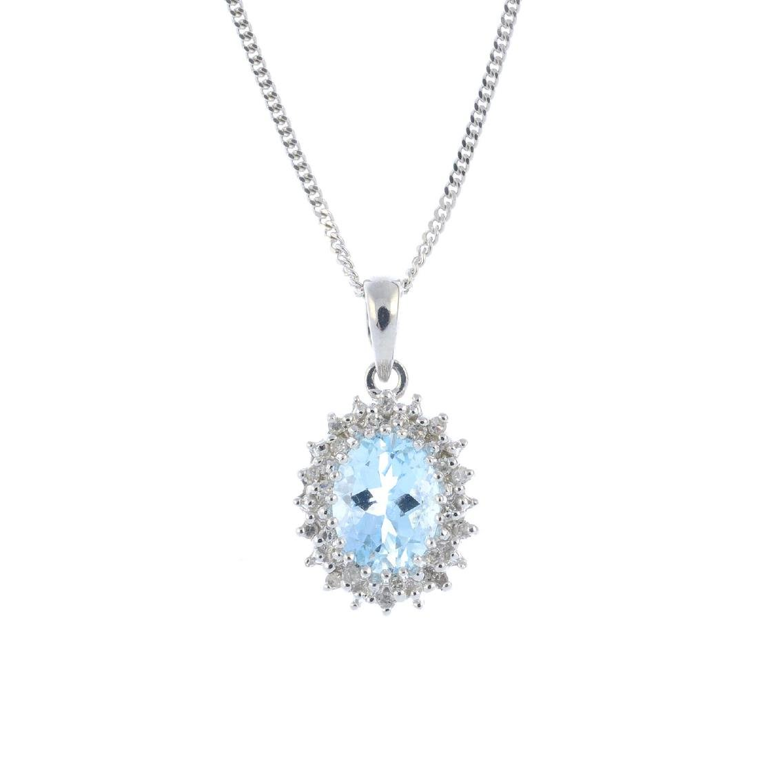A 9ct gold aquamarine and diamond cluster pendant. The