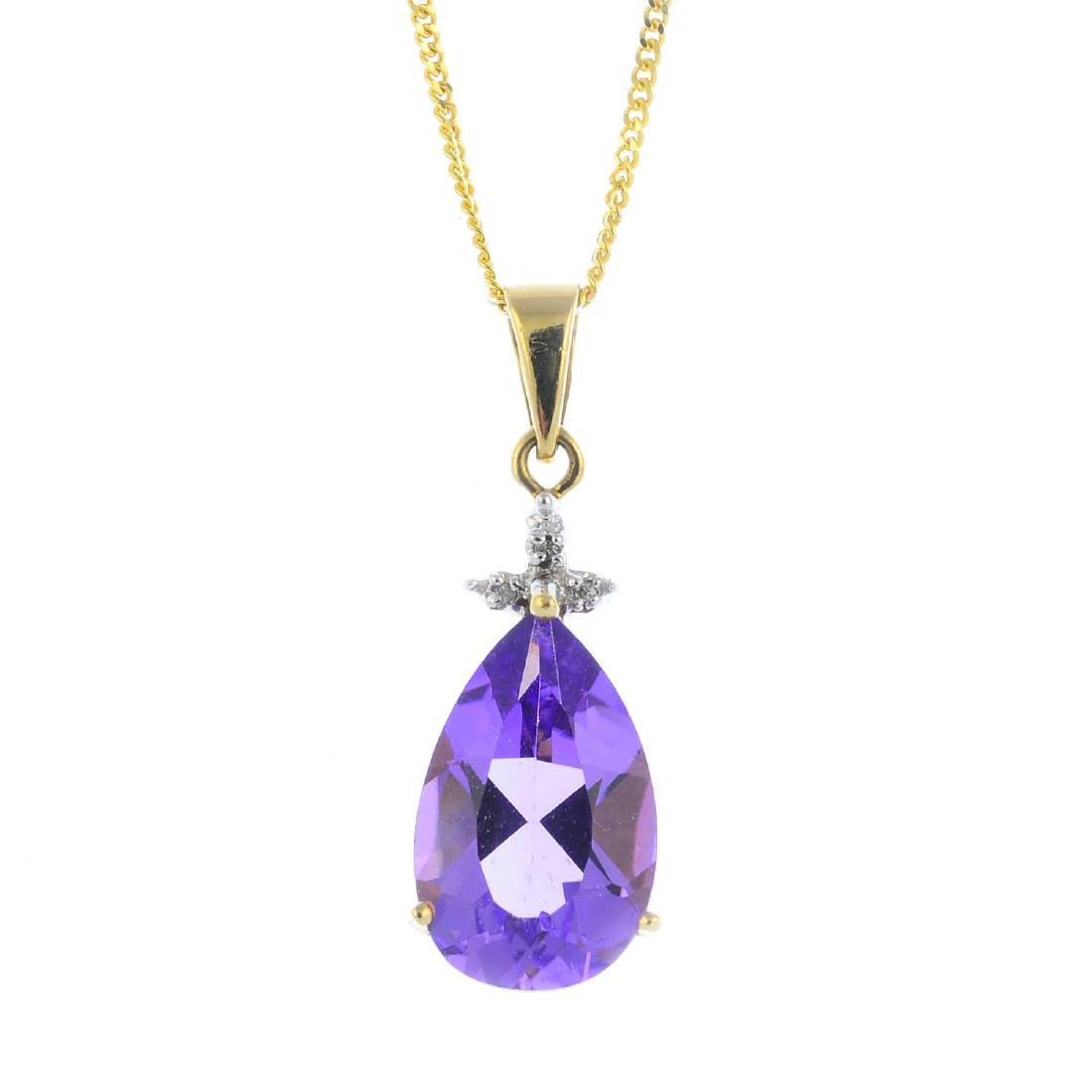 A 9ct gold amethyst and diamond pendant. The pear-shape
