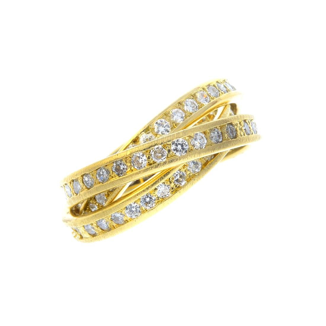 A diamond three-band full eternity ring. Designed as