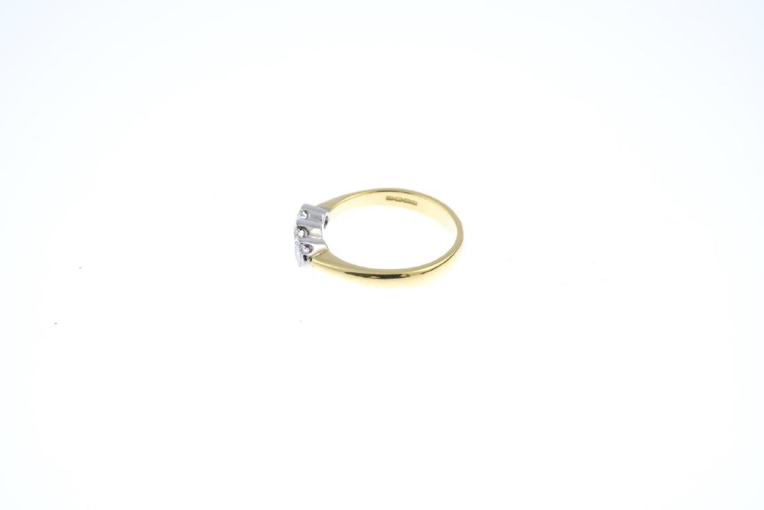 An 18ct gold diamond three-stone ring. The - 2