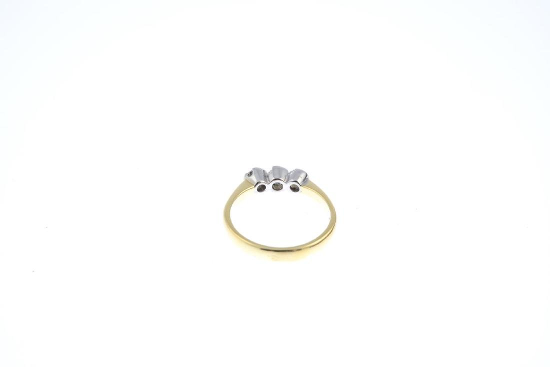 An 18ct gold diamond three-stone ring. The - 3