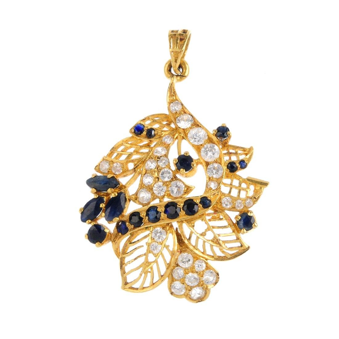 A sapphire and cubic zirconia pendant. Of foliate