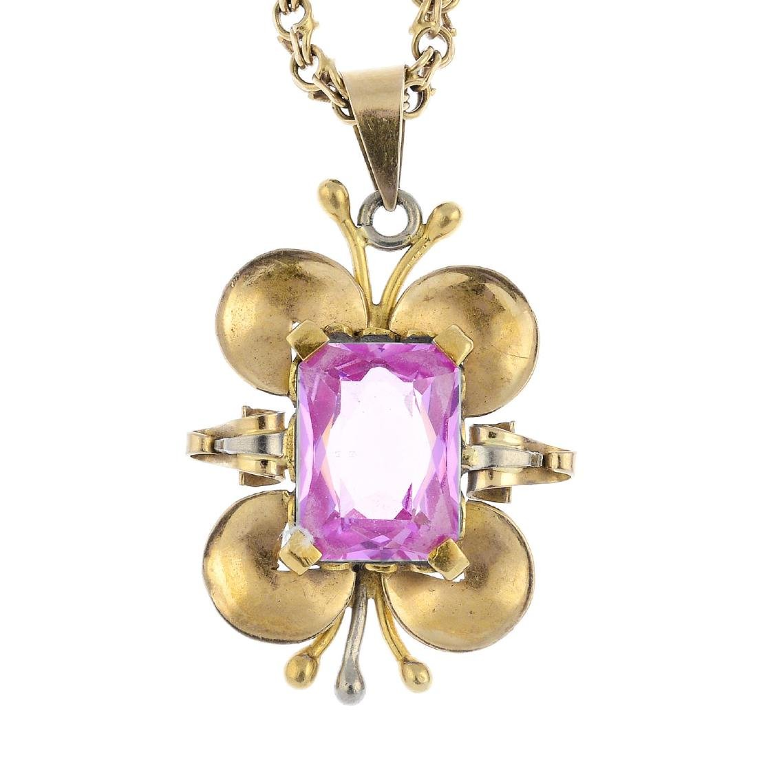 A synthetic sapphire pendant. Of bi-colour design, the
