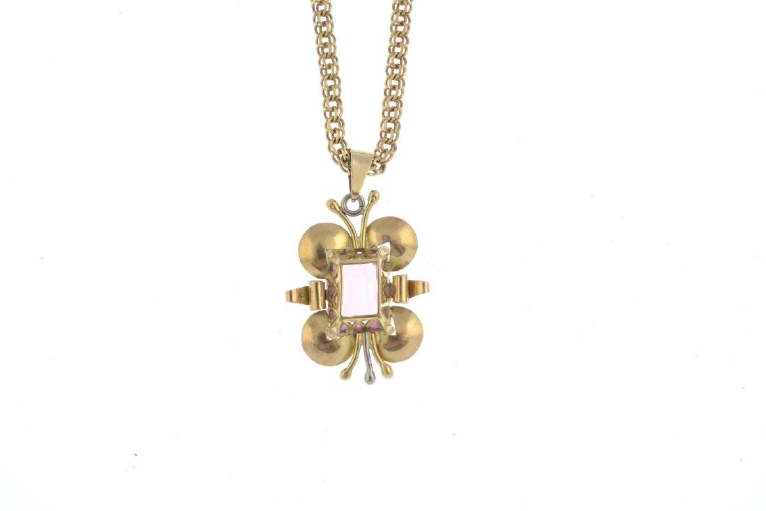 A synthetic sapphire pendant. Of bi-colour design, the - 2
