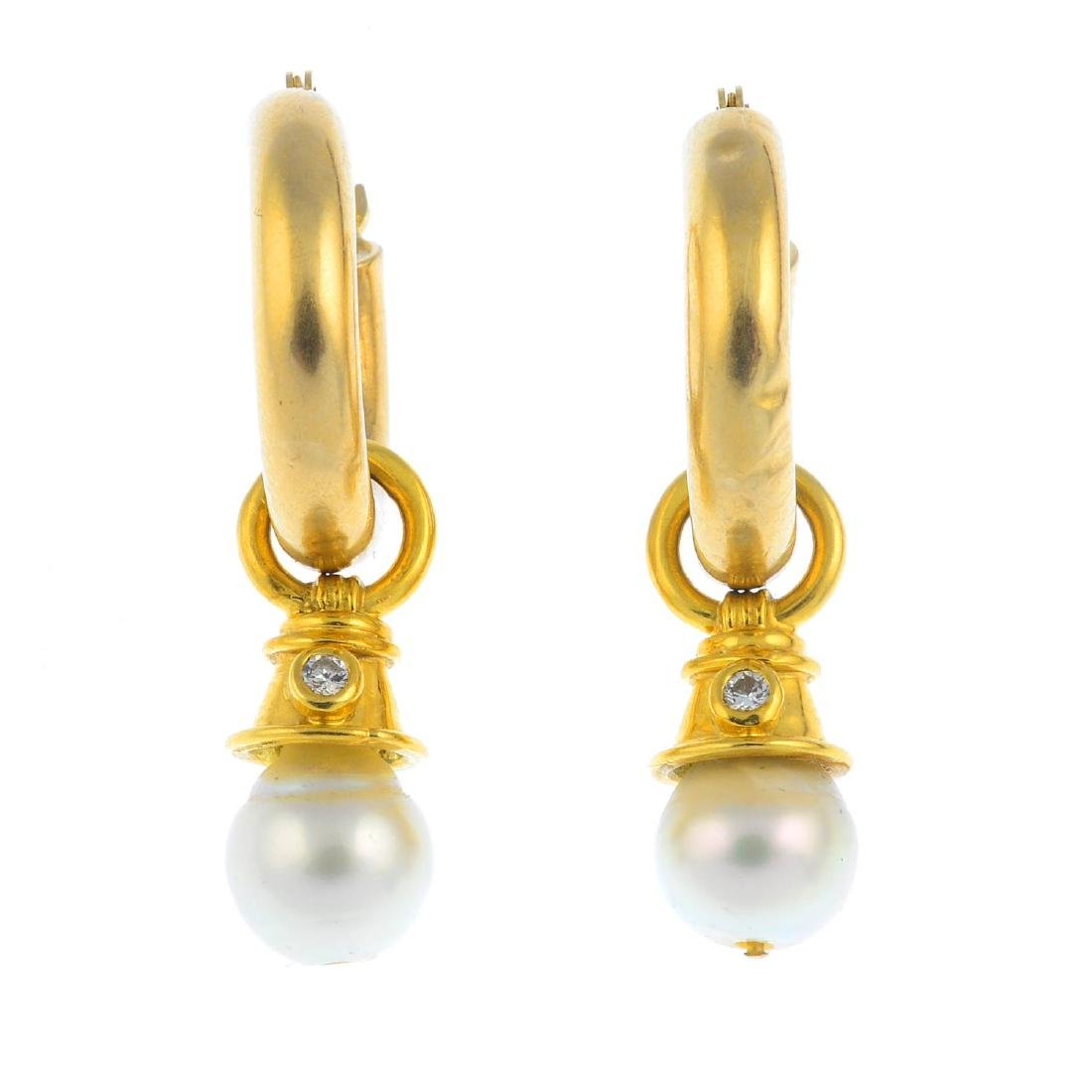 A pair of cultured pearl and diamond earrings. Each