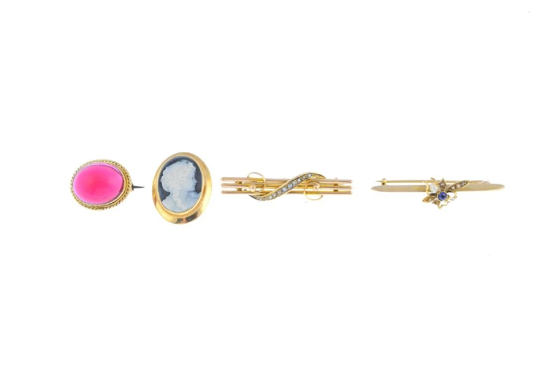 Four gem-set brooches. To include an early 20th century - 2