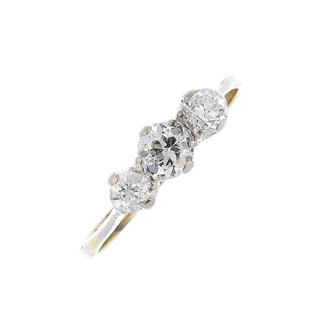 A diamond three-stone ring. The slightly graduated