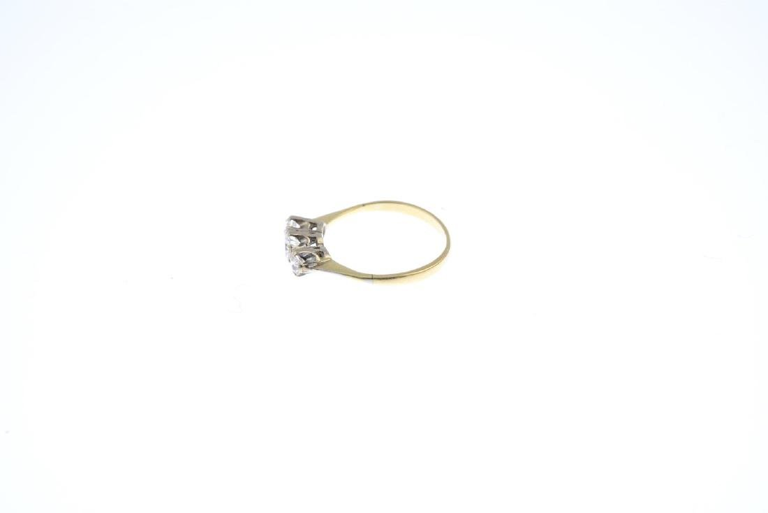 A diamond three-stone ring. The slightly graduated - 2