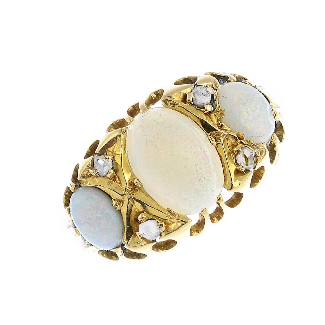 An Edwardian 18ct gold opal and diamond ring. The