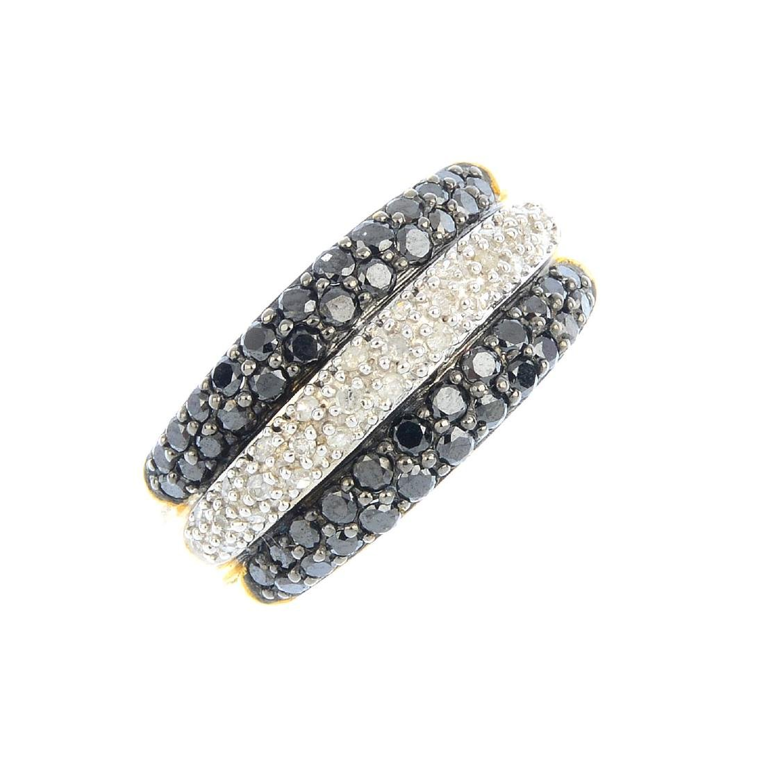 A diamond and black-gem dress ring. Designed as three
