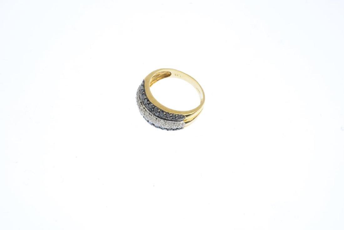 A diamond and black-gem dress ring. Designed as three - 3