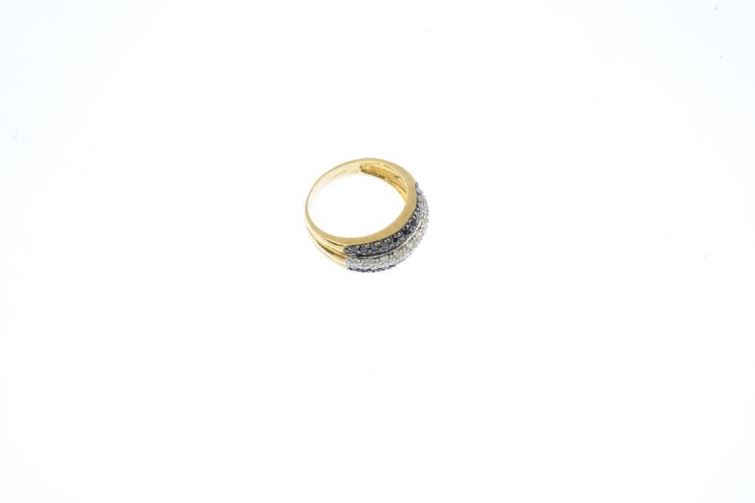 A diamond and black-gem dress ring. Designed as three - 4