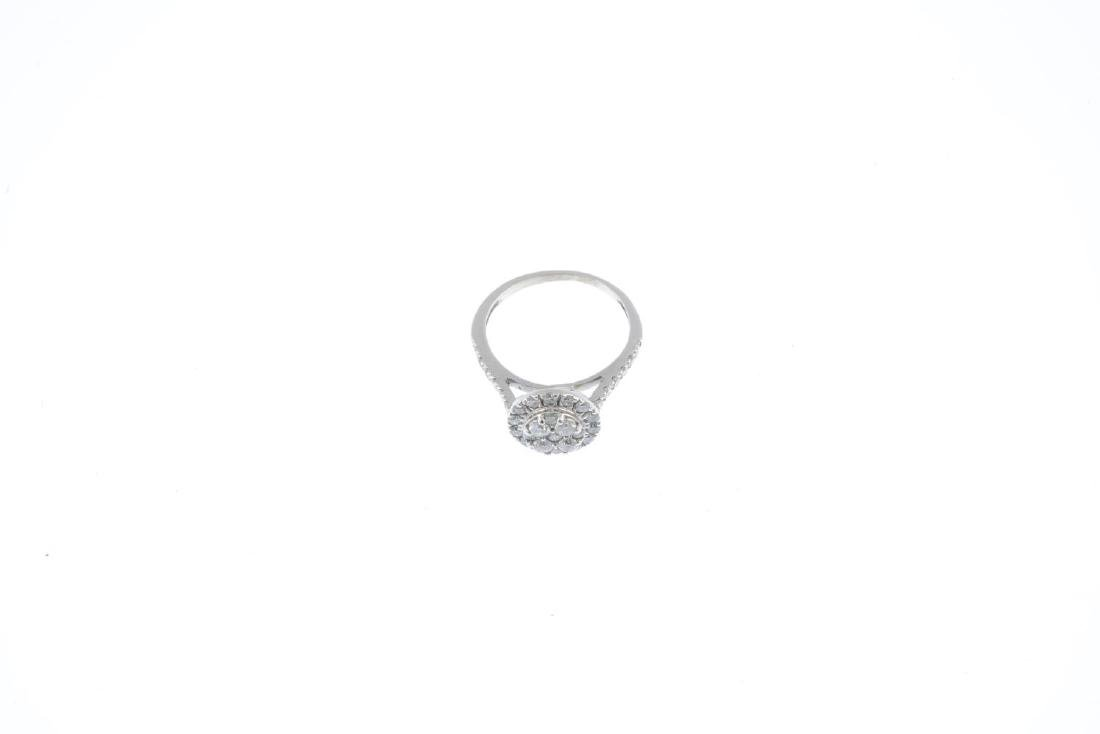 A diamond cluster ring. Of circular outline, the - 2
