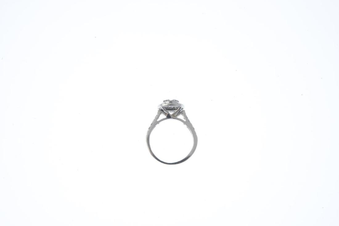 A diamond cluster ring. Of circular outline, the - 3