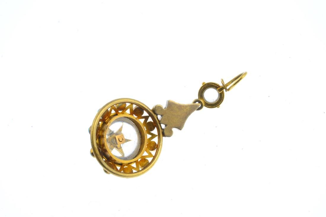 A late Victorian gold gem-set pendant. The circular - 2