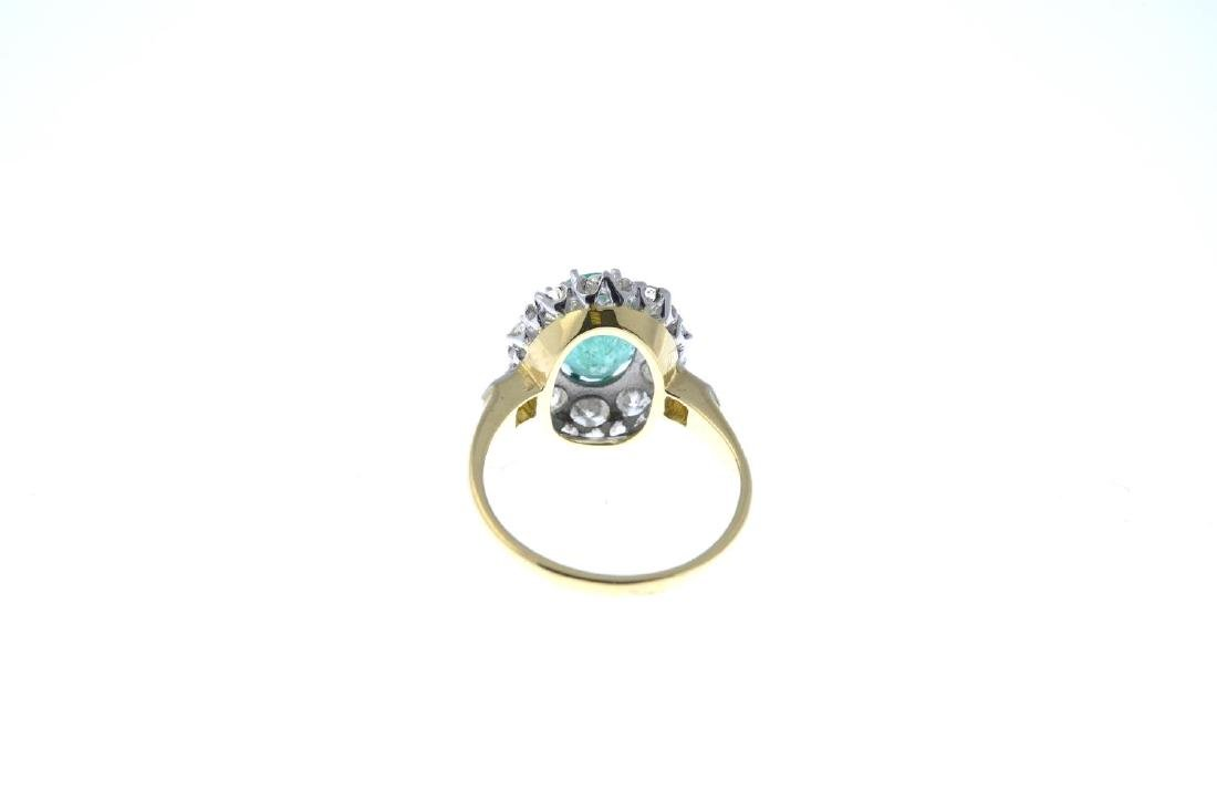 An emerald and diamond cluster ring. The oval-shape - 3