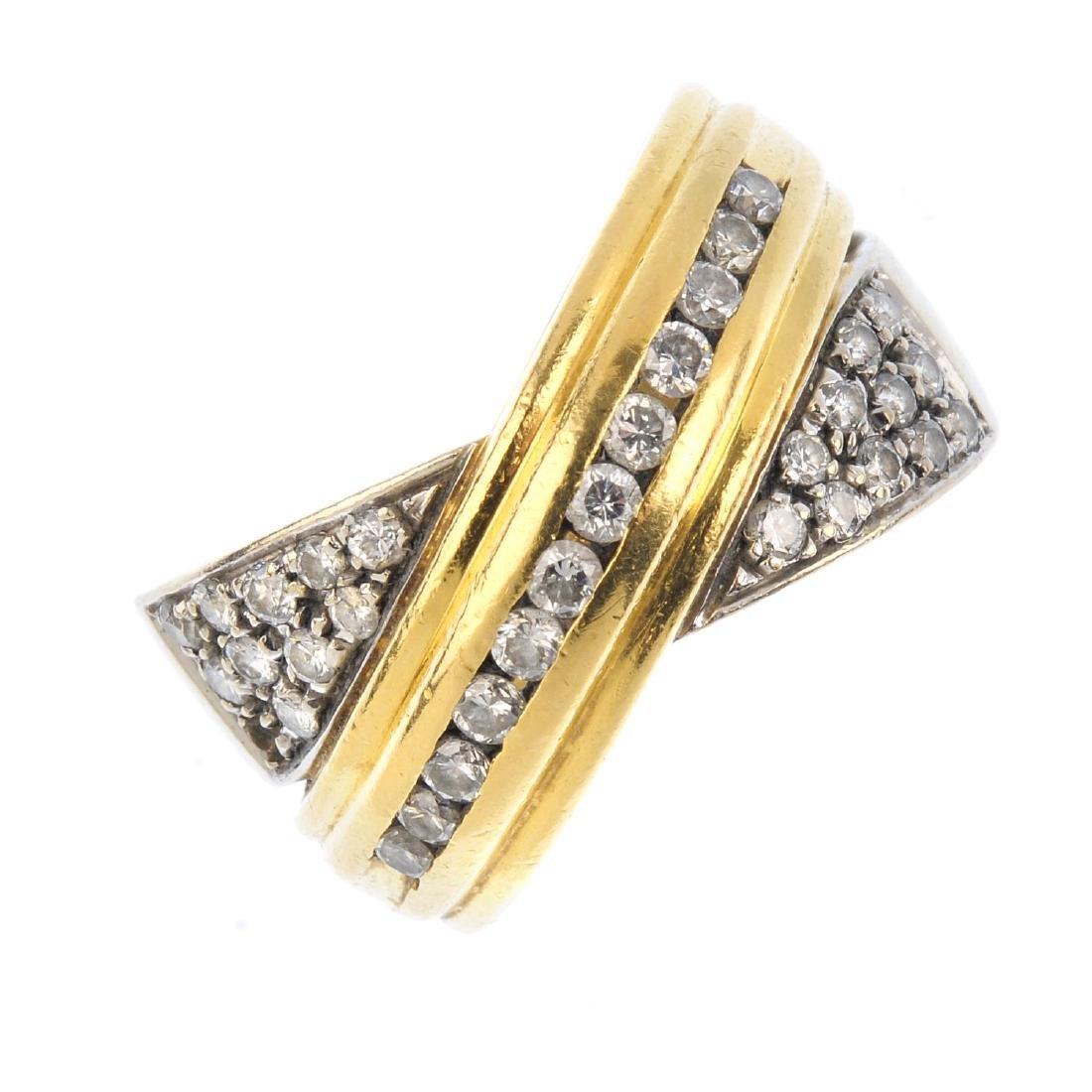 A diamond dress ring. Of bi-colour design, the