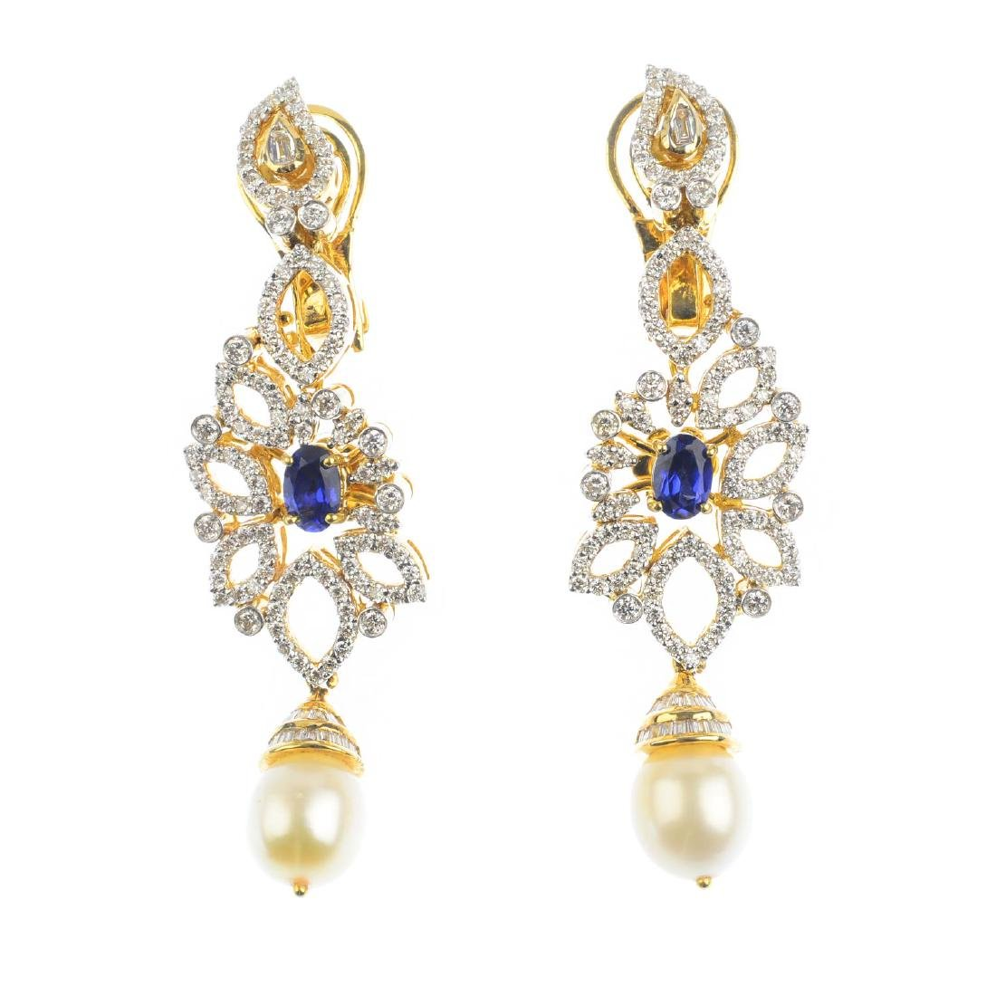 A pair of diamond and gem-set earrings. Each of