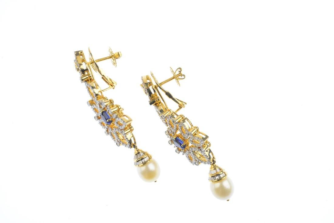 A pair of diamond and gem-set earrings. Each of - 2