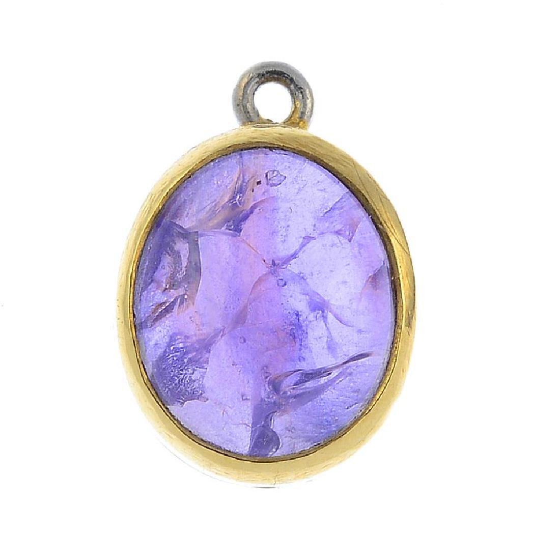 A star sapphire single-stone pendant. The oval purple