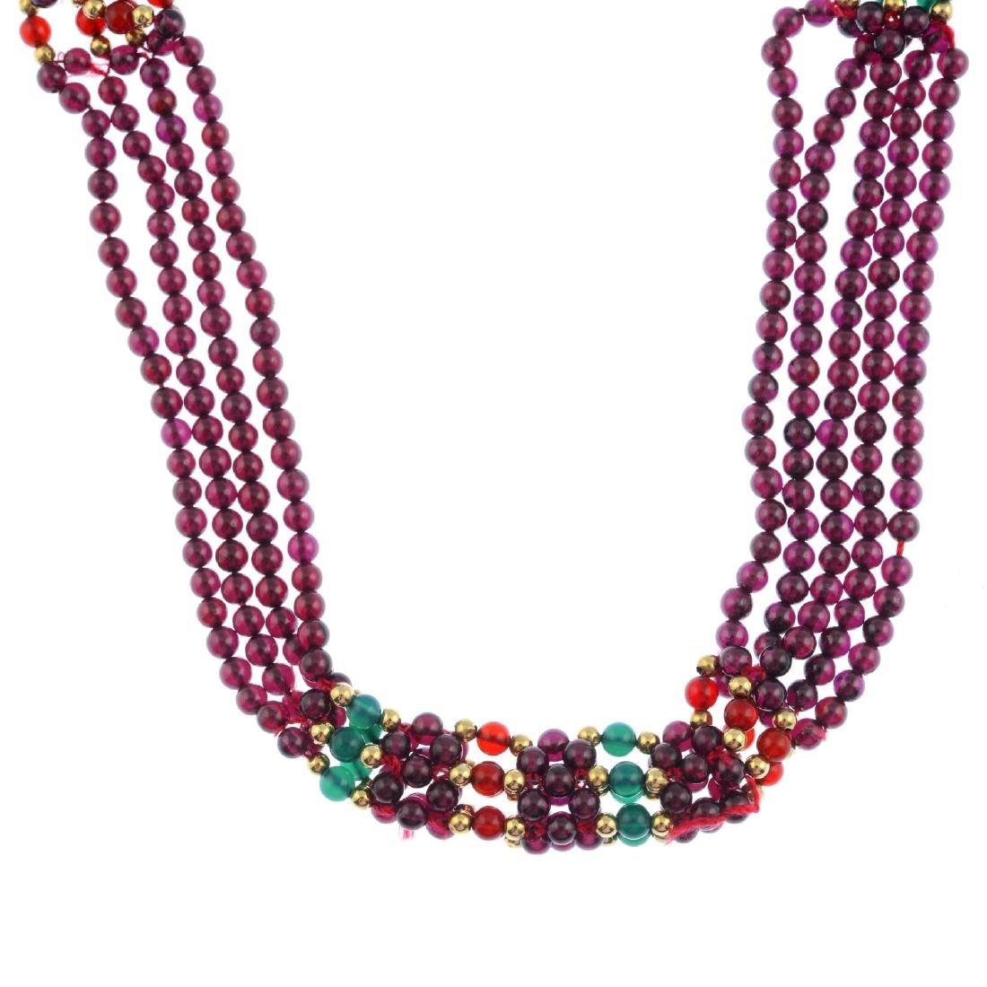A garnet bead necklace. Comprising five strands of