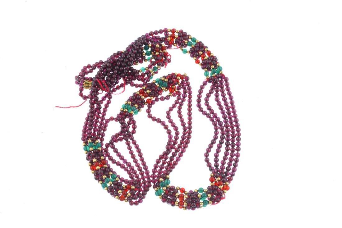 A garnet bead necklace. Comprising five strands of - 2