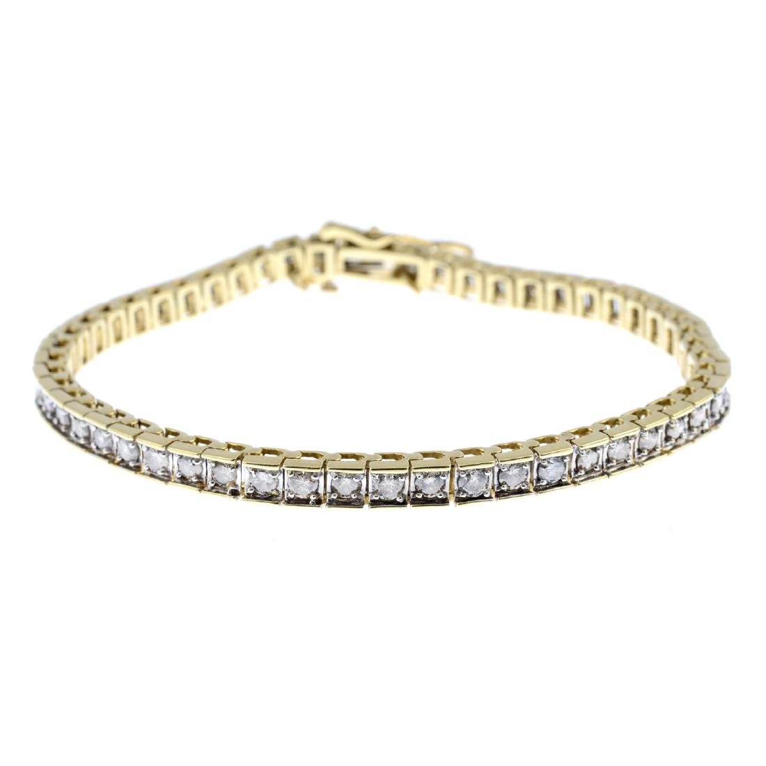 A diamond bracelet. The brilliant-cut diamond line,