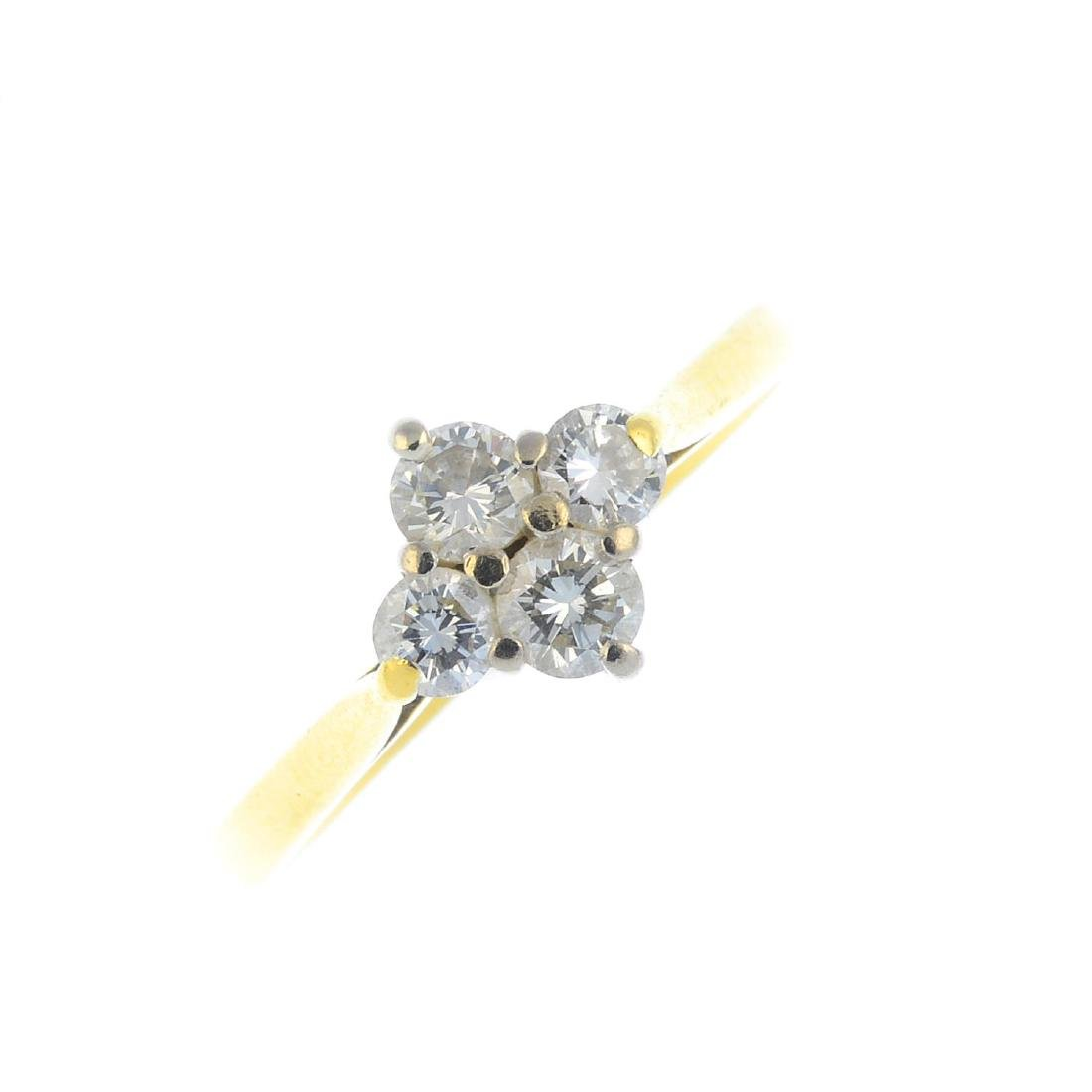 An 18ct gold diamond cluster ring. Designed as a