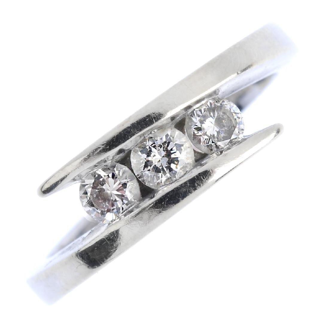 A 9ct gold diamond three-stone ring. The brilliant-cut