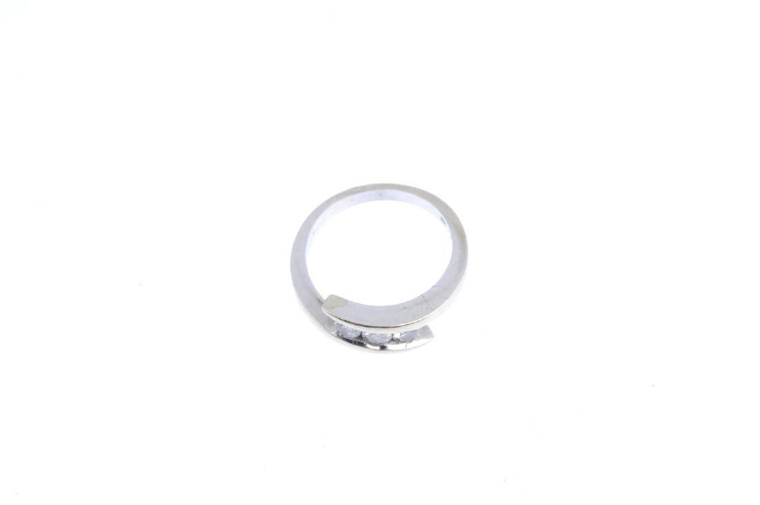 A 9ct gold diamond three-stone ring. The brilliant-cut - 2